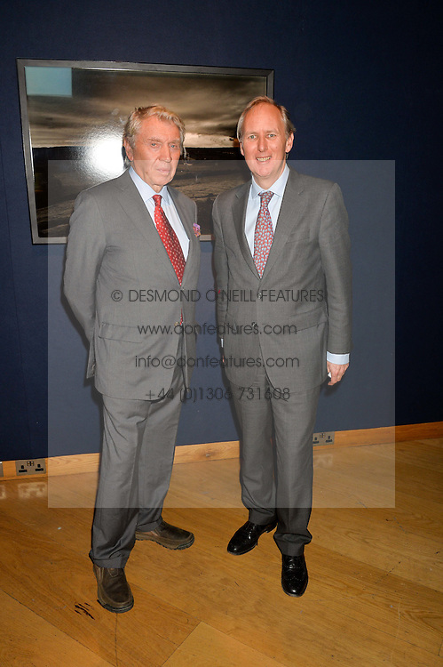 Left to right, DON McCULLIN and CHARLIE MAYHEW ceo of Tusk at a lecture featuring Don McCullin talking on War and Peace with Kate Silverton in aid of TUSK at Christie's, 8 King Street, London on 9th December 2015.