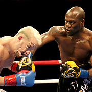 VERONA, NY - JUNE 09:  Francy Ntetu (R) punches Brian Holstein in the jaw with a right cross during a ShoBox boxing match at the Turning Stone Resort Casino on June 9, 2017 in Verona, New York. (Photo by Alex Menendez/Getty Images) *** Local Caption *** Francy Ntetu; <br /> Brian Holstein