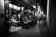 A restaurant on a narrow street in Cadiz, Spain