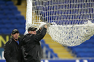Groundsmen dismantle the net and goalposts. Wales v Scotland, friendly international football match at the Cardiff City stadium, Cardiff, Wales, UK on Sat 14th Nov 2009.  pic by Andrew Orchard, Andrew Orchard sports photography