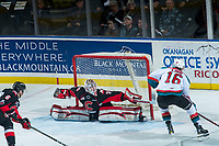 KELOWNA, CANADA - MARCH 14:  Taylor Gauthier #35 of the Prince George Cougars makes a first period save on shot by Kole Lind #16 of the Kelowna Rockets on March 14, 2018 at Prospera Place in Kelowna, British Columbia, Canada.  (Photo by Marissa Baecker/Shoot the Breeze)  *** Local Caption ***