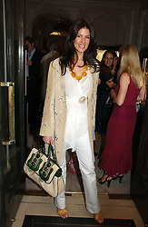CHRISTINA JUFFALI she was Christina Estrada at a party to celebrate the re-opening of the David Morris Flagship store at 180 New Bond Street, London on 14th June 2006.<br />