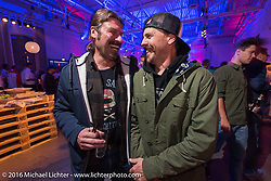 Roland Stocker (BMW) and Cameron Brewer (Roland Sands Design) at a great evening Intermot sponsored party at the very cool New Yorker / Dock One warehouse after another day at the Intermot Motorcycle Trade Fair. Cologne, Germany. Thursday October 6, 2016. Photography ©2016 Michael Lichter.