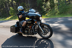 Custom motorcycle builder Jesse Rooke leads the annual Mayor's Ride during the 75th Annual Sturgis Black Hills Motorcycle Rally.  SD, USA.  August 3, 2015.  Photography ©2015 Michael Lichter.