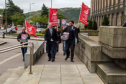 Pictured: Paul Sweeney, Labour and Co-operative MP for Glasgow North East,  and MSP James Kelly led workers to the front door of St Andrews House<br /><br />Paul Sweeney, Labour and Co-operative MP for Glasgow North East, was joined by MSP James Kelly and engineering workers as he handed in a petition at St Andrews House in Edinburgh today highlighting the final scheduled week of work at the St Rollox railway engineering works in Springburn which demands action to prevent the unnecessary loss of 200 skilled jobs in his constituency.<br /><br />Ger Harley | EEm 23 July 2019