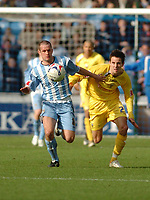 Photo: Leigh Quinnell.<br /> Coventry City v Preston North End. Coca Cola Championship. 01/04/2006. Coventrys Michael Doyle fights off Prestons Brian Stock.