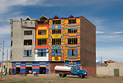 Bolivia. El Alto. Partly decorated building. Many buildings are left unfinished to void paying taxes.
