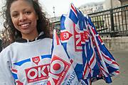 April 29th 2011 Royal Wedding. Trafalgar Square. Woman handing out Union Jacks, given away by OK magazine.
