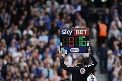 The fourth official holds up the electronic substitution board during the Sky Bet Championship match against Sheffield Wednesday at Craven Cottage, west London.