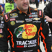 NASCAR Sprint Cup driver Tony Stewart is seen in the pits during the practice session prior to the NASCAR Sprint Unlimited Race at Daytona International Speedway on Saturday, February 16, 2013 in Daytona Beach, Florida.  (AP Photo/Alex Menendez)