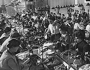 World War I 1914-1918:  War effort on the Home Front; Garment section of the National Women's Union making uniforms, Frankfort-am-Main, 1915.  Factory, Textile, Mechanisation, Sewing machine, Labour, Female