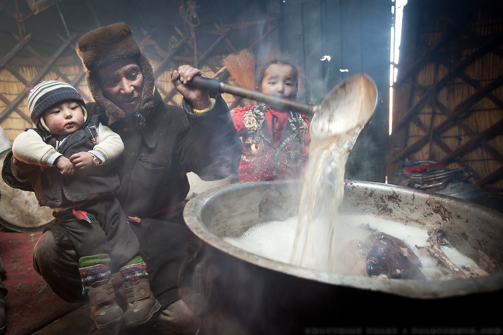 A father and his son and daughter are boiling a sheep in a yurt...In Jim Boi (son of Er Ali Boi) and Gul Soon's yurt. They are one of the very rare Kyrgyz still spending the whole winter in a yurt...The Kyrgyz settlement of Ech Keli, above Chaqmaqtin lake, Er Ali Boi's camp...Trekking through the high altitude plateau of the Little Pamir mountains, where the Afghan Kyrgyz community live all year, on the borders of China, Tajikistan and Pakistan.