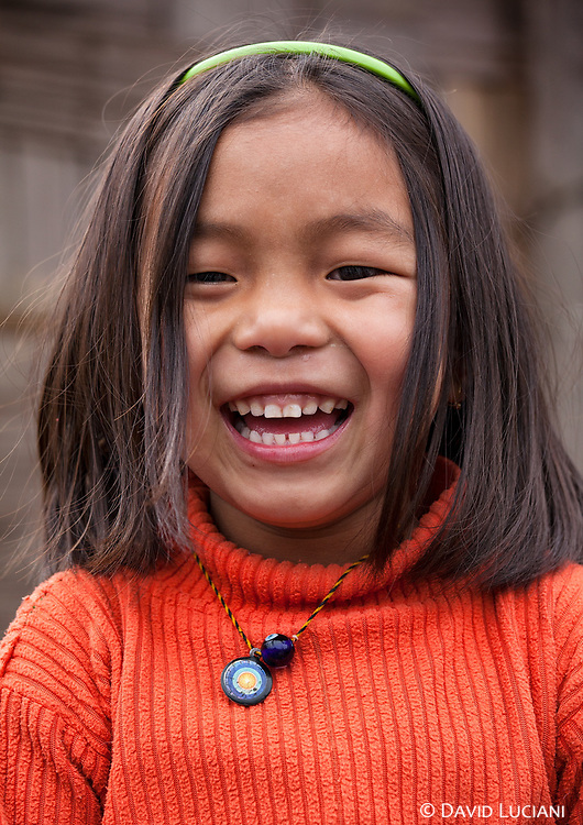 A girl wearing a Donyi-Polo pendant around her neck. Donyi Polo is the animist religion in which most of the tribes believe in Arunachal Pradesh.The divinities are the sun (Donyi) and the moon (Polo) also representing the energy of female and man.