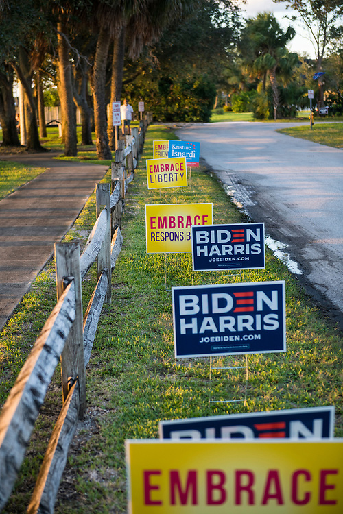 Biden Harris campaign signs outside Eastminster Presbyterian Church, a voting precinct in Indialantic, Florida, on November 3, 2020. Also in the mix are yellow signs encouraging Americans to embrace responsibility, liberty, and friendship.