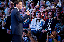 © London News Pictures. 24/09/2013 . Brighton, UK.  Actor STEVE COOGAN listening to Labour party leader ED MILIBAND deliver his Key-note speech on the third day of the Labour Party Conference in Brighton. Photo credit : Ben Cawthra/LNP