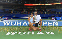 WUHAN, Sept. 30, 2017 Caroline Garcia of France poses with her coach on the awarding ceremony after winning the singles final match against Ashleigh Barty of Australia at 2017 WTA Wuhan Open in Wuhan, capital of central China's Hubei Province, on Sept. 30, 2017. Caroline Garcia won 2-1. wdz) (Credit Image: © Cheng Min/Xinhua via ZUMA Wire)