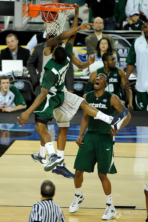 4 APR 2009: Donnell Beverly (2) of the University of Connecticut takes on Durrell Summers (15) of  Michigan State University during the semifinal game of the 2009 NCAA Final Four Division I Men's Basketball championships held at Ford Field in Detroit, MI.  Michigan State defeated Connecticut 82-73 to advance to the championship game.  © Brett Wilhelm