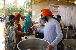 June 16, 2017 - Pakistan - LAHORE, PAKISTAN, JUN 16: Sikh people are receiving almsgiving at Gurdwara Dera Sahab .in Lahore on the occasion of religious rituals on Friday, June 16, 2017. (Credit Image: © PPI via ZUMA Wire)
