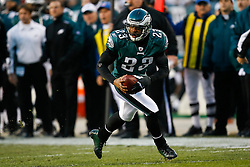 Philadelphia Eagles cornerback Dimitri Patterson #23 picks up a loose ball during the NFL game between the Denver Broncos and the Philadelphia Eagles on December 27th 2009. The ball was determined to be a dead ball. The Eagles won 30-27 at Lincoln Financial Field in Philadelphia, Pennsylvania. (Photo By Brian Garfinkel)