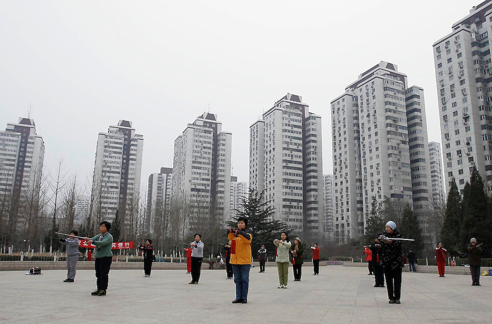 Early morning Tai Chi group in Yayuncun area park of Beijing, China.