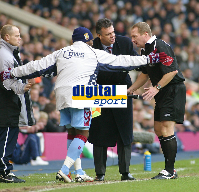 Photo: Dave Linney.<br />West Bromwich Albion v Aston Villa. The Barclays Premiership. 02/01/2006. Villa Mgr David O'Leary helps the linesman to his feet after he lost his footing.