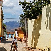 Central America, Cuba, Trinidad. Man on mule as a donkey taxi in Trinidad, Cuba.