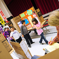 112113  Adron Gardner/Independent<br /> <br /> Students march through the isles of projects at the Red Rock Elementary science fair in Gallup Thursday.