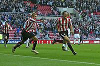 Photo: Andrew Unwin.<br />Sunderland v West Ham United. The Barclays Premiership.<br />01/10/2005.<br />Sunderland's Tommy Miller (R) wheels away after scoring his team's first goal.
