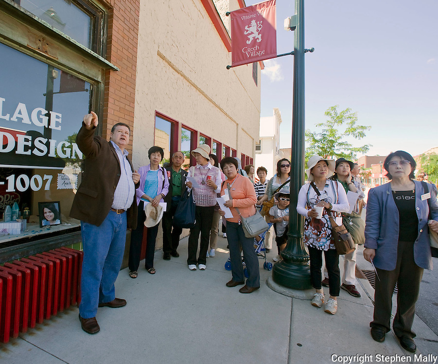 Sykora Bakery owner John Rocarek (left) points to the National Czech & Slovak Museum while on a walking tour of Czech Village during a stop by Friendship Force in Cedar Rapids on Wednesday, June 16, 2010. Twenty people from Gifu, Japan are on the Friendship Force trip to Iowa.