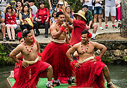 """Dancers of Tonga in the Canoe Pageant, """"Rainbows of Paradise."""" The Polynesian Cultural Center (PCC) is a major theme park and living museum, in Laie on the northeast coast (Windward Side) of the island of Oahu, Hawaii, USA. The PCC first opened in 1963 as a way for students at the adjacent Church College of Hawaii (now Brigham Young University Hawaii) to earn money for their education and as a means to preserve and portray the cultures of the people of Polynesia. Performers demonstrate Polynesian arts and crafts within simulated tropical villages, covering Hawaii, Aotearoa (New Zealand), Fiji, Samoa, Tahiti, Tonga and the Marquesas Islands. The PCC is run by the Church of Jesus Christ of Latter-day Saints (LDS Church). For this photo's licensing options, please inquire."""