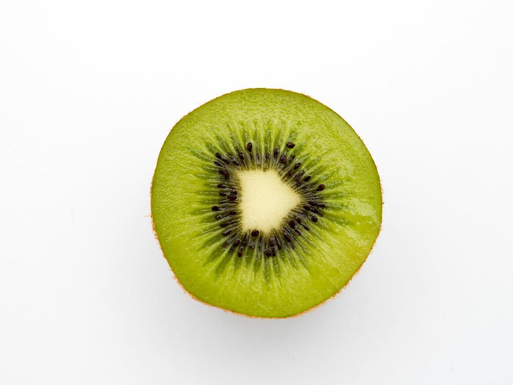 Single kiwifruit half on a white background