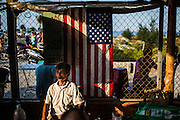 Nguyen Tien, who lost a leg to American artillery during the war at the 4th of July BBQ in Danang Vietnam. Christian Berg for the New York Times.