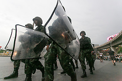 © Licensed to London News Pictures. 27/05/2014. Thai Army holding riot shields march during a Anti-Coup protest in Bangkok Thailand. yesterday Thailand's King formally approved Thai army chief General Prayut Chan-O-Cha as head of the nation's new military junta.  Photo credit : Asanka Brendon Ratnayake/LNP