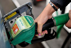 EMBARGOED TO 0001 MONDAY APRIL 15 File photo dated 15/8/13 of a person using an Asda petrol pump. Nearly four out of five (78%) UK households with a vehicle have a supermarket filling station on their doorstep, a study has found.