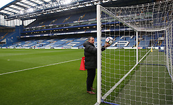 Referee Kevin Friend testing the goal-line technology prior to kick-off during the Premier League match at Stamford Bridge, London.