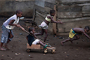 Children living in Roça Ribeira Funda are playing with wood carts, on the island of Sao Tome, Sao Tome and Principe, (STP) a former Portuguese colony in the Gulf of Guinea, West Africa.