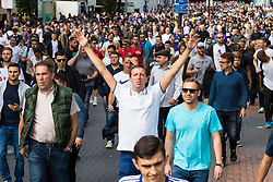 London, August 20 2017. Fans stream towards Wembley as Tottenham Hotspur host their first game of the Premier League season at their temporary home ground, Wembley Stadium, hosting Chelsea FC. © Paul Davey.