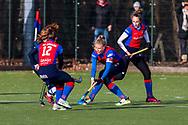 BILTHOVEN -  Hoofdklasse competitiewedstrijd dames, SCHC v hdm, seizoen 2020-2021.<br /> Foto: Caia van Maasakker (SCHC, captain) met Klaartje de Bruijn (SCHC) en Fabiënne Roosen (SCHC)
