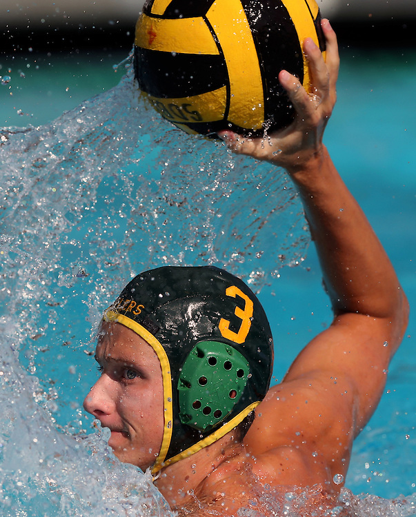Golden West College attacker JR Santoro (3) brings the ball out of the water and into shooting position during the Orange Empire Conference semi-final playoff game between the Saddleback College Gauchos and the Golden West College Rustlers at Saddleback College in Mission Viejo on November 4, 2016.<br /> <br /> Photo by Darren Yamashita / Sports Shooter Academy