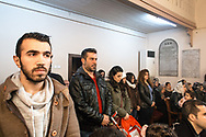 Mr Naim Leziye from Syria (2nd left wearing a red jumper), the acting head of the Syrian Christian community at the Samatya Kilisesi in Istanbul's historic Fatih neighbourhood during the Sunday service.