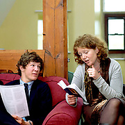 A teacher reads a passage to a male pupil from a book during an English lesson at Ampleforth College, North Yorkshire, UK. Ampleforth College is a coeducational independent day and boarding school in the village of Ampleforth, North Yorkshire, England. It opened in 1802 as a boys' school, and is run by the Benedictine monks and lay staff of Ampleforth Abbey.