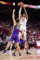 FAYETTEVILLE, AR - MARCH 4:  Jimmy Whitt Jr. #33 of the Arkansas Razorbacks shoots a jump shot over Marshall Graves #12 of the LSU Tigers at Bud Walton Arena on March 4, 2020 in Fayetteville, Arkansas.  The Razorbacks defeated the Tigers 99-90.  (Photo by Wesley Hitt/Getty Images) *** Local Caption *** Jimmy Whitt Jr.; Marshall Graves