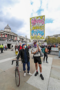 """People hold banners and placards during a """"Kill the Bill"""" demonstration in Trafalgar Square, central London on Saturday, May 1st, 2021. (Photo/ Vudi Xhymshiti)"""