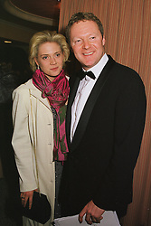 MISS ZOE APPLEYARD and comedian MR RORY BREMNER, at a dinner in London on 23rd February 1999.MOR 78
