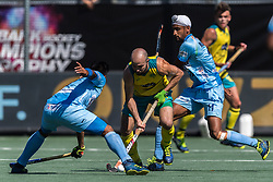(L-R) Manpreet Singh of India, Matthew Swann of Australia, Mandeep Singh of India during the Champions Trophy finale between the Australia and India on the fields of BH&BC Breda on Juli 1, 2018 in Breda, the Netherlands.