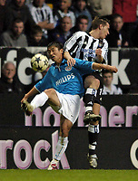 Photo. Jed Wee.<br /> Newcastle United v PSV Eindhoven, UEFA Cup Quarterfinal, St James' Park, Newcastle. 14/04/2004.<br /> PSV's Lee Young-Pyo (L) is clattered into by Newcastle's Darren Ambrose.