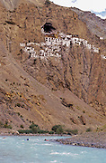 KAYAKING, ZANSCAR, INDIA Tsarap R exped, paddlers & Phuktal Monastery on cliff