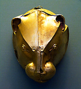 Silver rhyton in the shape of a bovine head with gold horns and rosette on the forehead. The muzzle, which has a pouring hole, is gold plated as were initially the eyes and the inside of the ears.