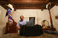 At home in Del Rio, Jay Johnson Castro packs for his walk along the border on Sunday, October 8, 2006.  Castro said he was walking over 200 miles from Laredo to Brownsville to protest the proposed border wall along the Rio Grande.