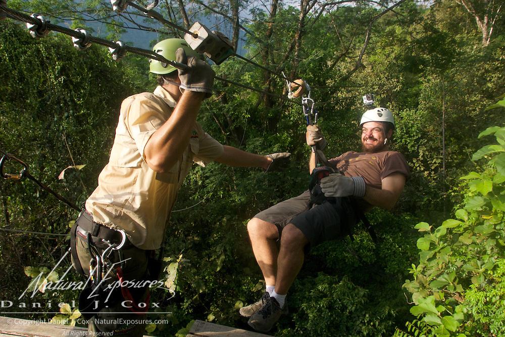 Esteban coming in on the zip line. Costa Rica.